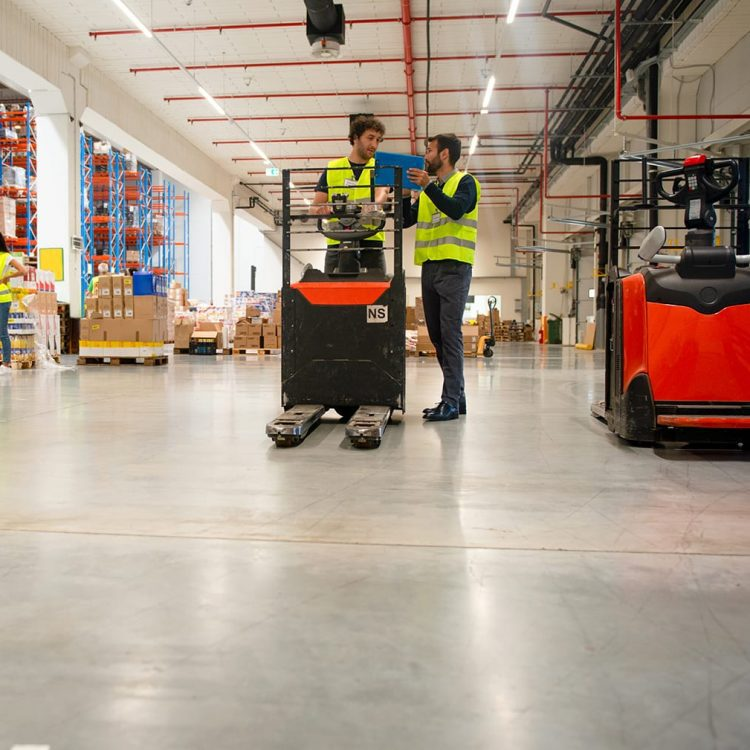 Training on a forklift, managers and workers